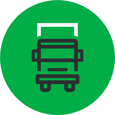 Green icon depicting truck carrying cross border cargo
