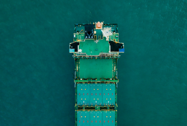 Birdseye view of a containership on the ocean, depicting visibility of a shipment.