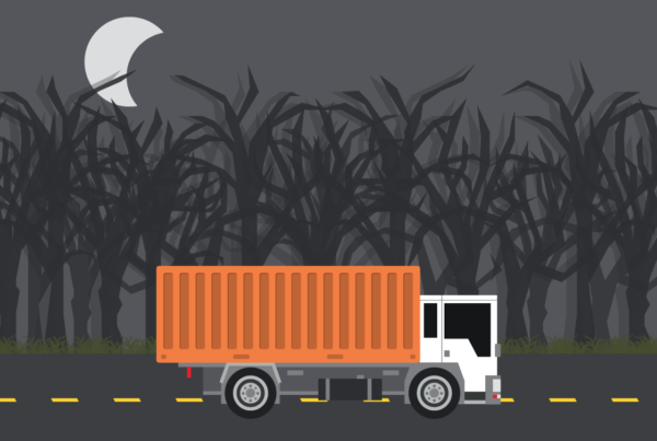 Illustration depicting semi truck hauling last mile freight though spooky forest