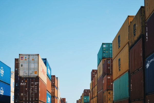 Photo of shipping containers stacked in a storage area